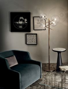 First Armchair & Pouf covered by velvet - Bolle Terra, floor lamp - Fante, side table with marble top - Tetris, glass coffee table.