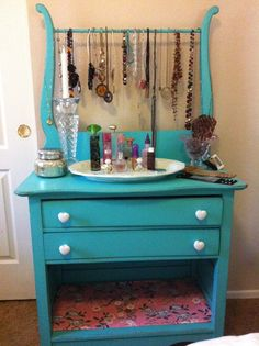 I painted this old washstand, distressed it a little, changed the knobs and added some great wrapping paper from Cost Plus World Market on the bottom shelf. I love it, it's my favorite piece in my bedroom.