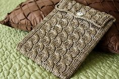 Cabled iPad Sleeve #pattern OR recycle an old sweater using the bottom edge...only need to sew two side seams...the bottom edge of sweater is already finished and just use the side seam of the sweater for one side of the slip cover.