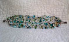 handknitted glass bead and wire bracelet by OnceAFawnATime on Etsy