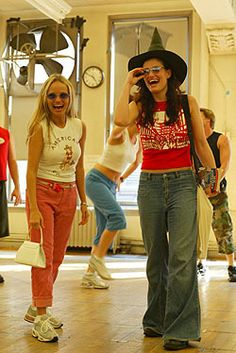 Kristin Chenoweth & Idina Menzel.....love the witch hat and purse with their street clothes :)