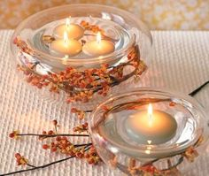 A fall wedding table centerpieces or table decorations with fall colors and floating candles. Floating Candle Centerpieces, Fall Wedding Centerpieces, Diy Centerpieces, Wedding Table, Table Decorations, Wedding Ideas, Trendy Wedding, Wedding Simple, Wedding Favors