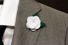A personal favourite from my Etsy shop https://www.etsy.com/listing/150510734/white-classic-wool-felt-rose-boutonniere