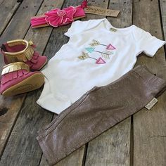 """Follow your arrow straight to DCS and pick up this adorable baby outfit!  #Arrow #onesie $19.99 any size available  #graciousmay #babymocs size 1-6 $64.99 #snugars bow $34.99 #silkberry leggings 3m-4T $9.99 #shopdcs #shoplocal #shopdavis #instashop #instafashion #babygirl #love"" Photo taken by @daviscountrystore on Instagram, pinned via the InstaPin iOS App! http://www.instapinapp.com (07/08/2015)"