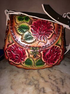 Authentic Hand-tooled Leather Purses. Traditional Mexican flower designs on genuine leather.