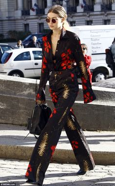 Gigi Hadid flashes a glimpse of her lacy black bra in a chic floral suit as she steps out during PFW | Daily Mail Online