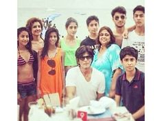 This rare picture of the actor along with his children Aryan and Suhana Khan was clicked during a getaway. Whats more is that Amitabh Bachchans grand-daughter Navya Naveli Nanda who is said to be a close friend of Aryan was also present in the gathering along with a bunch of friends. We cant help but agree that King Khan is a doting father! by #Filmfare. Shared by #BollywoodScope