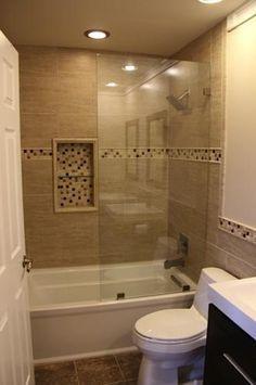 Frameless glass. Might use tub for hallway bath. User submitted photo