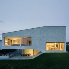 Split-level house works with the slope of the garden