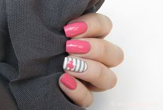 Pink polish with white and gray stripe accent nail. Cute!