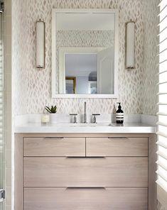 modern feminine bathroom with patterned wallpaper via @citysage