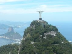 """Corcovado, meaning """"hunchback"""" in Portuguese, is a mountain in central Rio de Janeiro, Brazil. The 710-metre (2,329 ft) granite peak is located in the Tijuca Forest, a national park. It is sometimes confused with nearby Sugarloaf Mountain  Corcovado hill lies just west of the city center but is wholly within the city limits and visible from great distances. It is known worldwide for the 38-metre (125 ft) statue of Jesus atop its peak, entitled Cristo Redentor or """"Christ the Redeemer""""."""