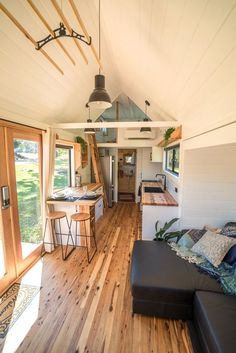 """Sojourner"" Tiny House by Australian-based Häuslein Tiny House Co. The ""Sojourner"" Tiny House by Australian-based Häuslein Tiny House Co.The ""Sojourner"" Tiny House by Australian-based Häuslein Tiny House Co. Best Tiny House, Tiny House Plans, Tiny House On Wheels, Small Tiny House, Modern Tiny House, Modern Houses, Pine Floors, Tiny House Living, Tiny House Bedroom"
