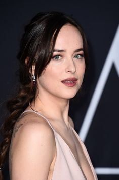 "Dakota Johnson Photos Photos - Actress Dakota Johnson attends the premiere of Universal Pictures' ""Fifty Shades Darker"" at The Theatre at Ace Hotel on February 2, 2017 in Los Angeles, California. - Premiere Of Universal Pictures' 'Fifty Shades Darker' - Arrivals"