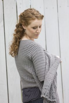 Go There Now A cardigan and shawl combine in this elegant garment, which can be worn open with shawl fronts, closed with a big belt, or with one or both shawl ends tossed over your shoulders for extra warmth. Elegant lace edges the shawl fronts. Designer: Simona Merchant-Dest Finished Size: 30½ (34, 37½, 42½, 46,…