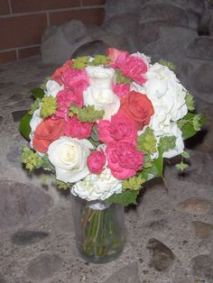 bridesmaid bouquet with hydrangea, white and orange roses, mini carns and green kermit mums.