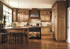 ... glaze or maybe Toasted Almond. The cabinet is Caldwell Maple. It is