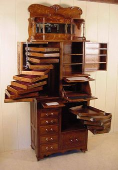 Secretary Desk with collection drawers for jewelry or whatnots.