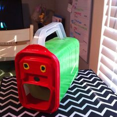 Interactive very hungry caterpillar with story pieces.  Made using storage container covered with green tape? Cool idea!