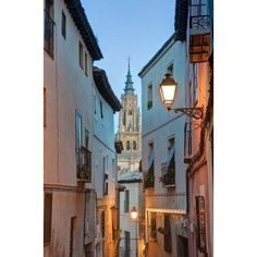 Alleyway and Toledo Cathedral Steeple Toledo Spain Canvas Art - Rob Tilley DanitaDelimont (19 x 29)