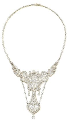 A Belle Epoque Diamond Necklace, Early 20th Century. Of openwork scroll design, millegrain-set with old European-, single-cut, cushion-shaped and rose diamonds, connected by knife-edge linking, mounted in platinum and gold, French import, assay and maker's marks, fitted box stamped Fontana Frères, embossed with the initials 'N.R.' surmounted by an Earl's coronet.