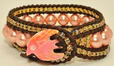 Carved Seashell Bird button closure on 3 Layer Leather & pearl Wrap Bracelet from SeaSide Strands.
