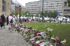 """""""Grief in the public domain"""". Flowers, candles and greetings at Oslo Cathedral."""