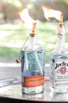 For those trying to make the most of what's left of the warm weather this year, here is a great tutorial by Sugar & Charm on making homemade tiki torches from glass bottles.