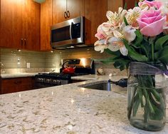 Glass tile backsplash paired with a quartz countertop