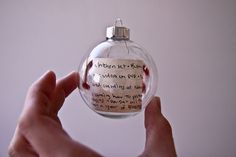 Kids Christmas list in an ornament with the year. It would be so cool to go back and see what the children asked for years ago. Absolutely love this idea! - Click image to find more Holidays  Events Pinterest pins --  would also be cool to make a list of your favorite memories from that year, write them down an then every year you could reminisce! :)