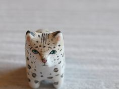 "Snow Leopard pocket totem figurine. 42.00, via Etsy. polymer, 1.5"" nose to tail,painted, sev. coats matte varnish"