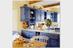 now this is gorgeous Country Blues Adding a classic shade of blue to your kitchen is a quick way to get the cozy country look. Instead of painting a solid wall or coating your cabinets, opt for a washed stain – instant vintage chic.