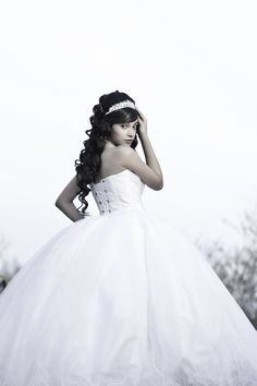 quinceanera portraits - girl looking over her shoulder to show back of dress