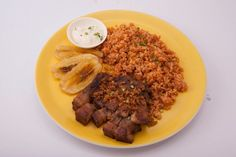 Mexican rice plate:  Fried banana chips, pork chop, friend rice and mayonnaise dip.