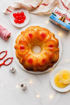 A pineapple upside down pound cake with pineapple rum sauce overhead shot with pineapple and cherry garnishes Pineapple Rum, Pineapple Upside Down Cake, Apple Cake Recipes, Dessert Recipes, Pudding Recipes, Best Birthday Cake Recipe, Cube Steak Recipes, Sour Cream Pound Cake, Rum Cake