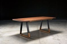 The Griswold Dining Table  Solid American Walnut Top 2 thick. Extremely durable matte conversion varnish. Blacked steel base with walnut insert. #modernfurnitureapartment