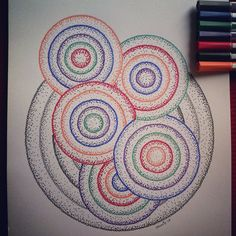 Another one done. I dotted untill I couldn't see straight.  It's a colourful one.