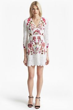 """<ul> <li> Floral cotton-lace dress with multicoloured embroidery and embellishment</li> <li> Deep V-neck with white embroidered trim</li> <li> Long sleeves in sheer lace</li> <li> Concealed back zip fastening and hook closure</li> <li> Lined at body</li> <li> UK size 10 length is 85cm</li> </ul>  <strong>Our model is 5ft 11"""" and is wearing a UK size 8. </strong>"""