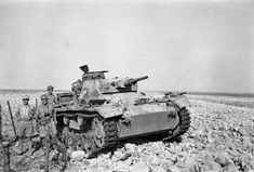 With field glasses hanging around his neck, Lieutenant Colonel J. Crawford and a detachment of Australian infantrymen pose with a German tank that was destroyed during Rommel's unsuccessful attack on Tobruk in Easter North African Campaign, Erwin Rommel, Afrika Korps, Work Horses, Ww2 Tanks, World War Ii, Troops, Military Vehicles, Norte