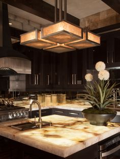 Stainless steel isn't just for appliances anymore. This contemporary chandelier features stainless steel mesh with light mica. | Hammerton