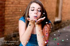 Senior Photography Session by True Foundation Photography #truefoundationphotography #pose #glitter #rainbow #color #photography #dress #senior #session #blue #brick #wall #makeup
