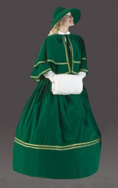 Victorian Caroler Costume: Out of the pages of a Dickens' novel, the classic attire of London Town 1800's conjures imaginings of gas lit cobblestone streets and open air markets.  4-piece set: reversible cape (plaid taffeta inside), skirt, faux fur muff, velvet hat.