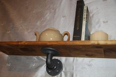 industrial pipe fittings and wood shelf