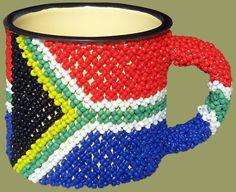 South African flag tin cup, designed with Zulu-style beadwork. - Karen Bennett - South African flag tin cup, designed with Zulu-style beadwork. South African flag tin cup, designed with Zulu-style beadwork. South African Flag, South African Design, Durban South Africa, South Afrika, African Colors, African Style, Africa Flag, African Crafts, Zulu