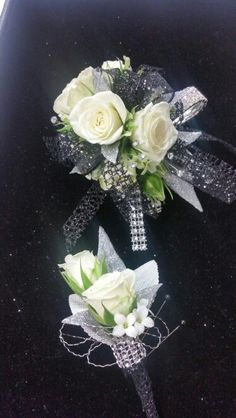 White spray roses with black and silver accents corsage and bout