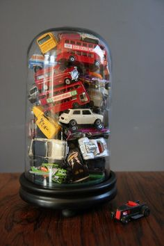 Love this -- what a nice memory jar for kids. Fill with cars, or legos, or balls, whatever YOUR child play(ed) with in a bell jar memories on a shelf. Matchbox Autos, Matchbox Cars, Matchbox Car Storage, Glass Dome Display, Toy Display, Deco Kids, Ideas Para Organizar, The Bell Jar, Kid Decor