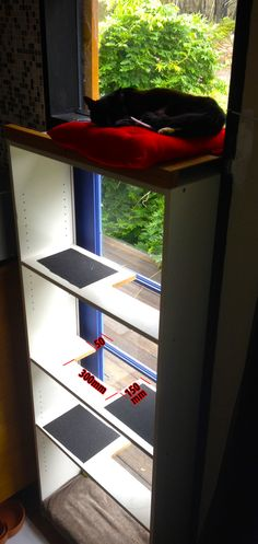 Materials required Cat, suitable window, Billy bookcase, squares of non-slip rug underleys (gray squares in pics), cushion with ties on one side (colour MUST complement cat's colour!) sheet wood for penthouse platform about 400 x 400 mm, wood spacer to lift outside of penthouse platform to about level – I used 75 x 50 x [&hellip