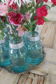 Mason Jar Flower Vase - Pinned from a free digital magazine creation platform Uses For Mason Jars, Blue Mason Jars, Mason Jar Flowers, Bottles And Jars, Flower Vases, Glass Jars, Flower Arrangements, Wire Flowers, Small Flowers