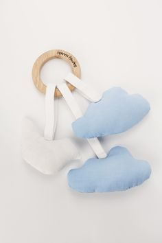 Baby teether little clouds and a bird. Made by Sapnu namai. Find more accesories and baby bedding www.littledreamsbutique.com