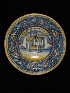 A Maioloica dish celebrating the art of the potter. Dish Place of origin: Deruta, Italy (probably, made) Date: 1520-40 (made) Artist/Maker: Unknown (production) Materials and Techniques: maiolica, painted with colours Museum number: 659-1884